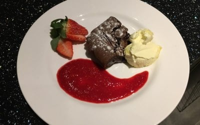 Chocolate and pecan nut brownie with raspberry coulis and clotted cream