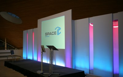 Rear projection stage set with light-boxes