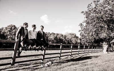 Groomsmen on the fence