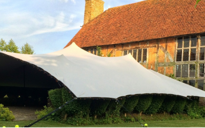 stretch tent joined to house by intent productions