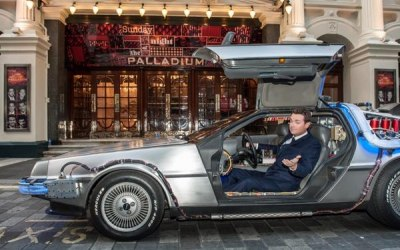 The BTTF Car Delorean Time Machine being used in Opening Title of Sunday Night at the Palladium 2014