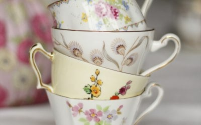 Stack of four vintage china cups