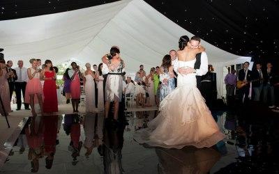 Black dance floor, starcloth, flat white linings, wedding marquee