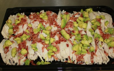 Chicken platter with blue cheese dressing, bacon and avocado