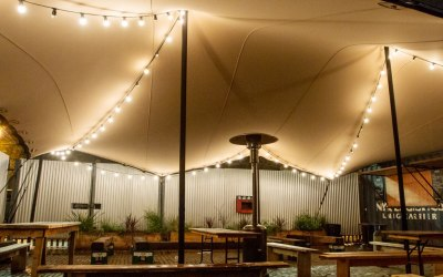 Underneith a stretch tent at a bar by intent productions