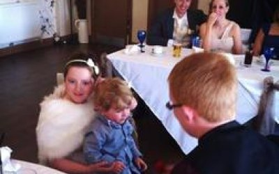 Performing magic for children at a wedding