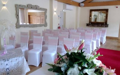 Coral wedding sashes and white spandex chair cover hire london