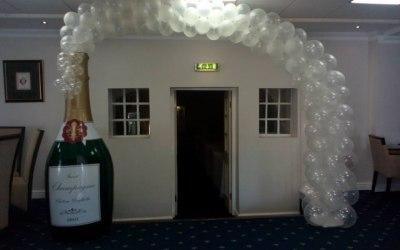 Champagne bottle balloon arch