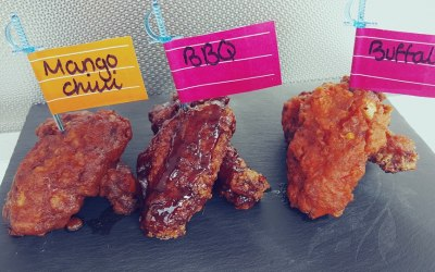 Our Banging Wings Tossed in 3 home made sauces Smokey Bar B  Mango Chili  Buffalo