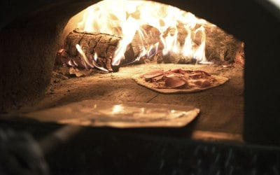 All Fired Up Pizzas - Fresh Pizza being cooked in the Wood Fired Oven