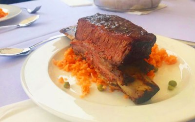Smoked beef ribs on a bed of savoury rice