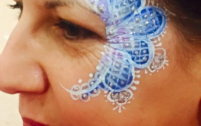 Glittery Blue Lace Eye Design by London Face Painters Happy Canvas