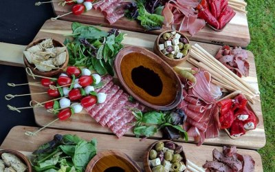 Antipasti sharing platters served as starter for company corporate dinner party.
