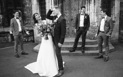 Bride and groom laughing at relaxed wedding at Berkeley castle