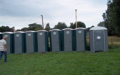 Single portable toilets at an event