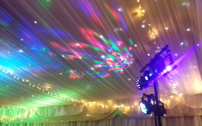 Disco lights on draped ceiling