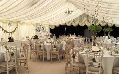 Royston Marquees white marquee theme with reveal wall
