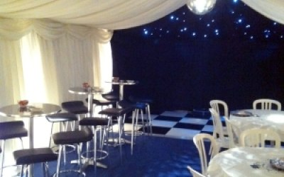 Chrome Poseur Tables and Chairs and White Bistro Chairs