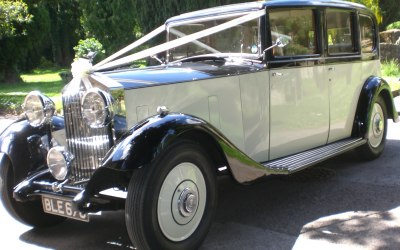 "1934 ""Harrods"" Rolls-Royce attending a wedding."