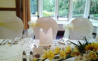 White Stretch Chair Covers + Lemon Organza Sash
