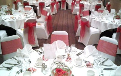 White Stretch Chair Covers + Red Organza Sash