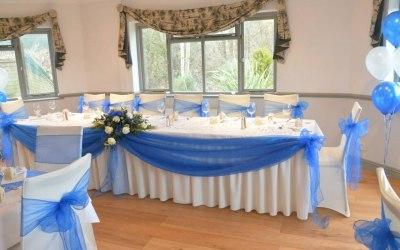 Ivory Stretch Chair Covers + Royal Blue Organza Sash