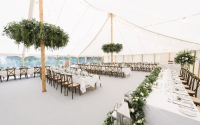 Petal Pole marquee with crossback chairs and light grey carpet