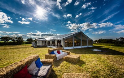 Wedding marquee with straw bale sofas!