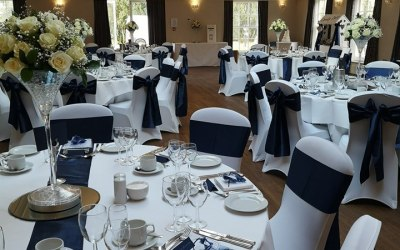 A range of chair covers and sashes for hire, including setup and collection. Centerpieces also available for hire in silk or fresh arrangements.