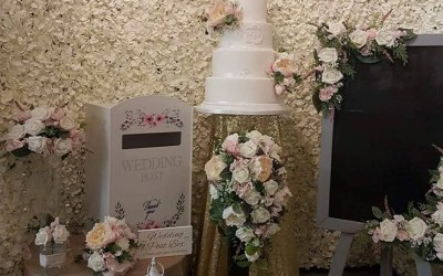 Flower wall, chalk board, centerpieces and post boxes available on hire.