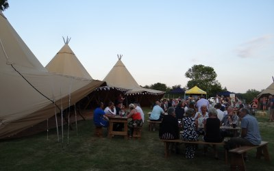 A tipi party on a warm summer evening
