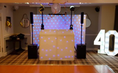 40th Birthday Party 2019. Modern white set-up with LED backdrop and light up numbers.