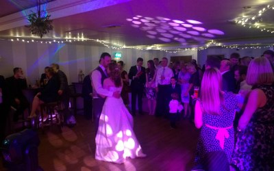 First Dance embrace with heart projections