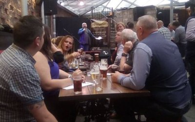 "A busy crowd at ""The Clutha"" in Glasgow enjoy a quiz."