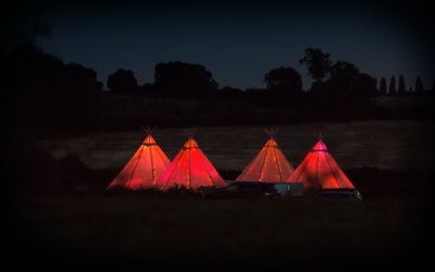 4 Giant tipis set up for an event