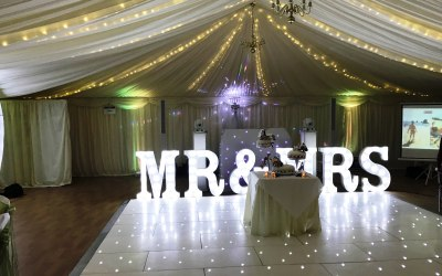White LED dance floor and letters at Mulberry House.