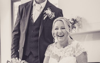 Ruth and Dave thoroughly enjoyed their wedding day! They couldn't stop laughing whilst signing the register!