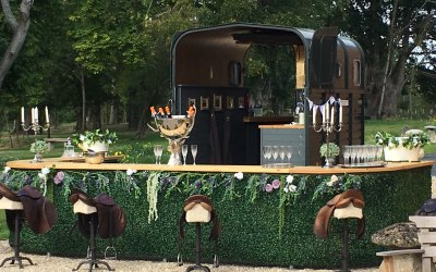 Our beautiful larger bar setup & our famous saddle stools