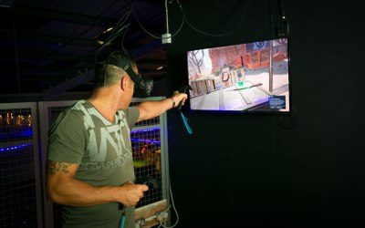 An Adult in VR Zombie Shooting Multiplayer