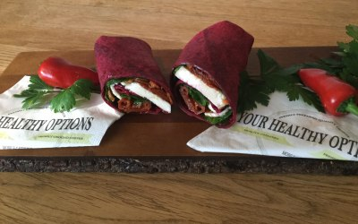 Beetroot or spinach wrap with sundried tomatoes, halloumi and salad.
