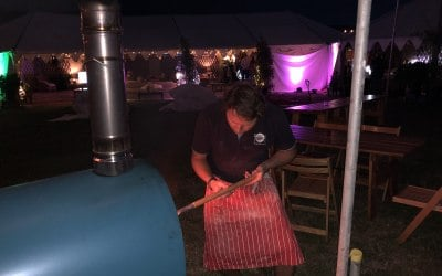 Making pizza at CarFest South 2018
