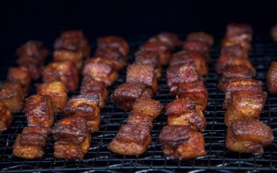 SMOKED PORK CANDY KNOWN AS BURNT ENDS CRUNCHY OUTSIDE GLAZED IN BBQ AND TENDER INSIDE.