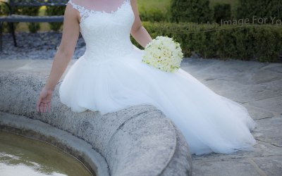 Bride by the water fountain