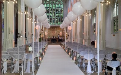 Verical Chair sashes and balloons for a wedding ceremony at St John's church Hyde Park