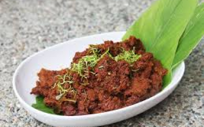 Beef Rendang - Flaky Beef Chunks, coated in a rich dry curry, slow pulled to capture the aroma of the Far East