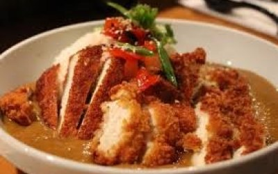 Chicken Katsu - Crispy fried chicken strips, slathered in a tasty Katsu curry sauce, Laced with crispy onions and chilli flakes