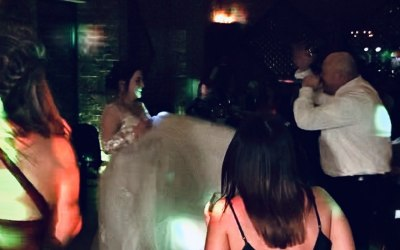 Ric dancing with crowd at a beautiful barn wedding