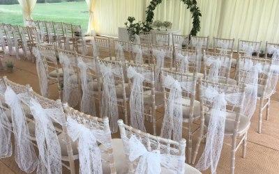 White lace sashes over chiavari chairs