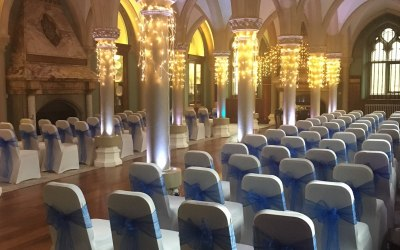 White chair covers and royal blue organza sashes