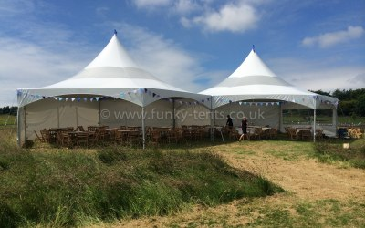 2 Hex Marquees linked and opened up at the front for a summer lunch.